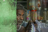 Typical Indian Man in a shop — Stock Photo
