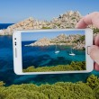 Taking picture with Smartphone in Sardinia — Stock Photo #40024791