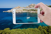 Taking a picture with Smartphone in Sardinia — Stock Photo