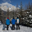 Hikers on a snowy Trail, enyoing the view — Stock Photo