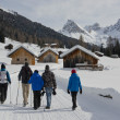Group Hiking on snowy Trail to mountain Huts — Stock Photo #40253053