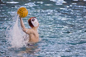 Boy playing waterpolo — Stock Photo