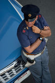 Policeman near his car — Stock Photo