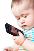 Child looks at the phone and thought — Foto Stock