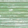 Old green painted wood wall - texture or background - Stock Photo