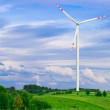 Wind turbine, renewable energy. Landscape with blue sky. — Stock Photo #26946657