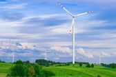 Wind turbine, renewable energy. Landscape with blue sky. — Stock Photo
