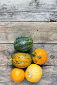 Pumpkins on a wooden table , backrounds — Stock Photo