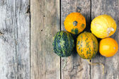 Pumpkins on a wooden table , backrounds — Стоковое фото