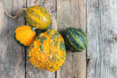 Pumpkins on a wooden table , backrounds — Stok fotoğraf