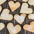 Stock Photo: Heart of cookies and wooden background.