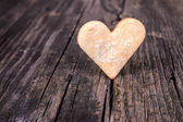 Heart of the cookies and the wooden background. — Stock Photo