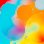 Oil drops in water on a coloured background — Stock Photo