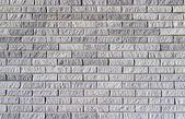 Achtergrond textuur van een grijze bakstenen muur — Stockfoto