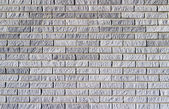 Background texture of a grey brick wall — Stock Photo