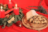 Typical German Christmas cake and advent wreath — Stock Photo