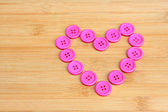 Heart of pink buttons — Stock Photo