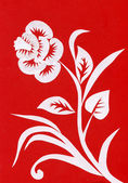 White flower on a red background — Stock Photo