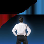 Business man backside with graph — Stock Photo