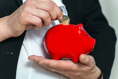 Close up pregnant business womans hands with piggy bank — Stock Photo