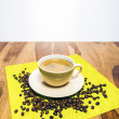 Stock Photo: Coffee with beans on serviette