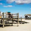 Beach chairs and buildings of St. Peter-Ording, Germany — Stock Photo