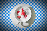 Cup with strawberry splash — Stock Photo