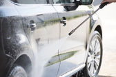 Car and pressure washer — Stock Photo