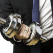 Businessman with silver dumbbell — Stock Photo #28494039