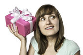 Pretty girl listens to a gift — Stock Photo