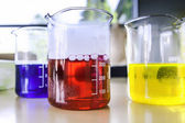 Three lab measuring glasses — Stock Photo
