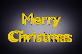 Golden Merry Christmas lettering on grey — Stock Photo