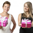 Two women with presents — Stock Photo