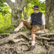 Sitting traditional Bavarian man — Stock Photo