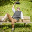 Bavarian man on bench — Stock Photo