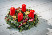 Advent wreath with burning red candles — Stock Photo