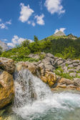 Waterfall and rocks in the Austrian Alps — Stock Photo