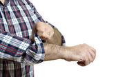 Man rolls up sleeves — Stock Photo