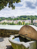 Well and riverside in Passau — Stock Photo