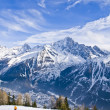 Skiing at French Alps - Stock Photo