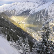 Chamonix Valley lit by the Sun - Stock Photo