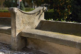 The stone bench in the square — Stock Photo