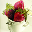 Stock Photo: Fresh strawberrys on tae cup