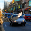 Woman catching a car — Stock Photo