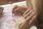 Female artist painting a portrait — Stock Photo