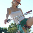 Young girl is riding a bicycle — Stock Photo #37859643