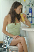 Beautiful woman enjoying her drink at the cafe terrace — ストック写真