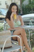 Beautiful woman enjoying her drink at the cafe terrace — Photo