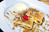 Pancakes crepes with ice cream — Stock Photo