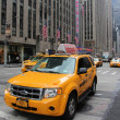 Yellow SUV taxi cab — Stock Photo